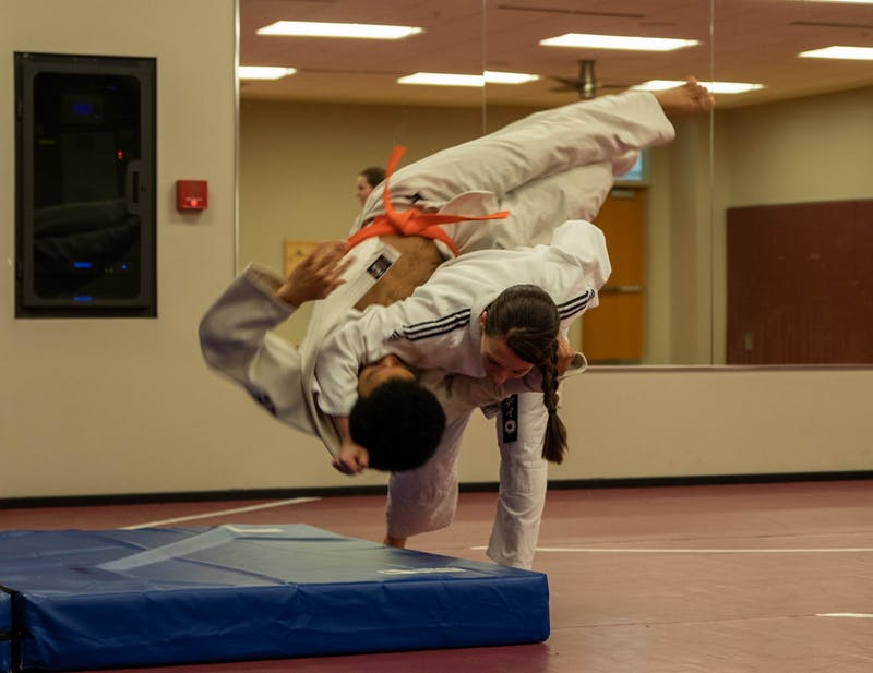 Sensei Wendy Koslicki practices throws David Mitchell during judo practice Feb. 22, 2020, in the Jo Ann Gora Recreation and Wellness Center. Koslicki started judo 19 years ago. Jaden Whiteman, DN