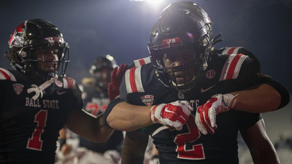 Ball State senior running back Caleb Huntley celebrates after scoring a touchdown in the fourth quarter against the Eagles Nov. 11, 2020, at Scheumann Stadium. Huntley ran for 204 yards and three touchdowns. Jacob Musselman, DN