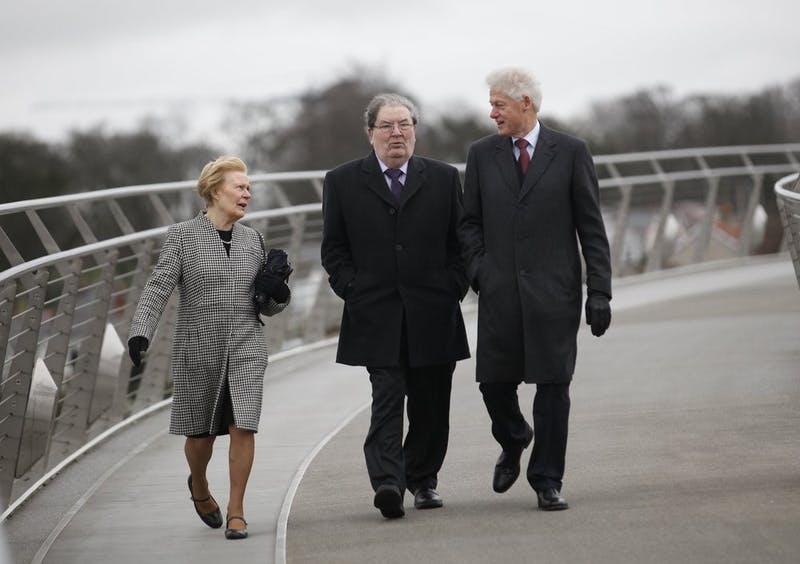 In this March 5, 2014 file photo former US President Bill Clinton, right, with former Social Democratic Labour Party leader John Hume and Hume's wife Pat walk across the Peace Bridge, in Londonderry Northern Ireland. The family of politician John Hume, who won Nobel Peace Prize for work to end violence in Northern Ireland, says he has died. He was 83. The Catholic leader of the moderate Social Democratic and Labour Party , Hume was regarded by many as the principal architect behind the peace agreement. (AP Photo/Peter Morrison)