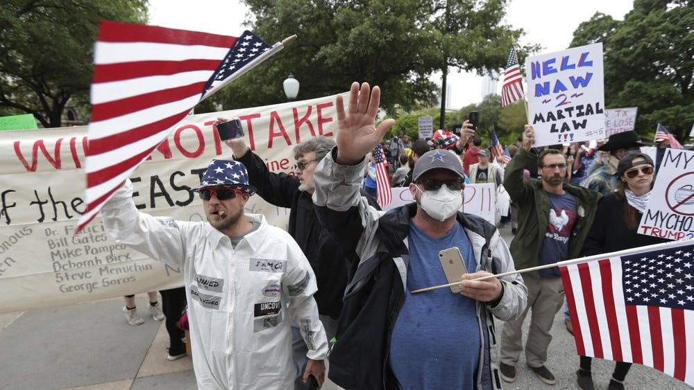 Protesters rally at the Texas State Capitol to speak out against Texas' handling of the COVID-19 outbreak, in Austin, Texas, Saturday, April 18, 2020. Austin and many other Texas cities remain under stay-at-home orders due to the COVID-19 outbreak except for essential personal. (AP Photo/Eric Gay)