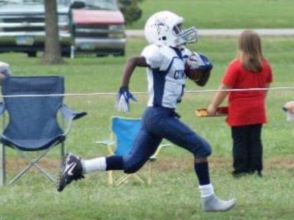 Growing up playing multiple sports, freshman wide receiver Qian Magwood runs the ball in 2014 while playing youth football. He continued his football career throughout high school before arriving at Ball State. Qian Magwood, photo provided.
