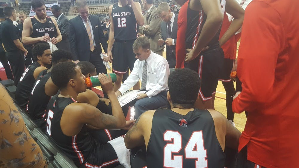 Ball State Men's Basketball players huddle around head coach James Whitford during a timeout in the first half against IUPUI Dec. 1, 2018, at the Indiana Farmers Coliseum in Indianapolis. Five players in double-figures led the Cardinals to an 85-75 win. Zach Piatt, DN