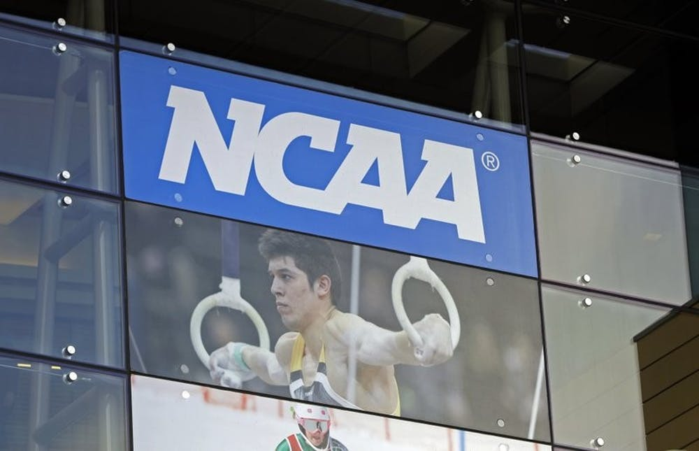 <p>In this April 25, 2018, file photo, the NCAA headquarters is shown in Indianapolis. The NCAA is expected to approve a recommendation to all athletes who compete in fall sports, including football, over the next 10 months to not be charged a year of eligibility. It&#x27;s great news for current players, but comes with some complications for teams, coaches and future college football players. <strong>(AP Photo/Darron Cummings, File)</strong></p>