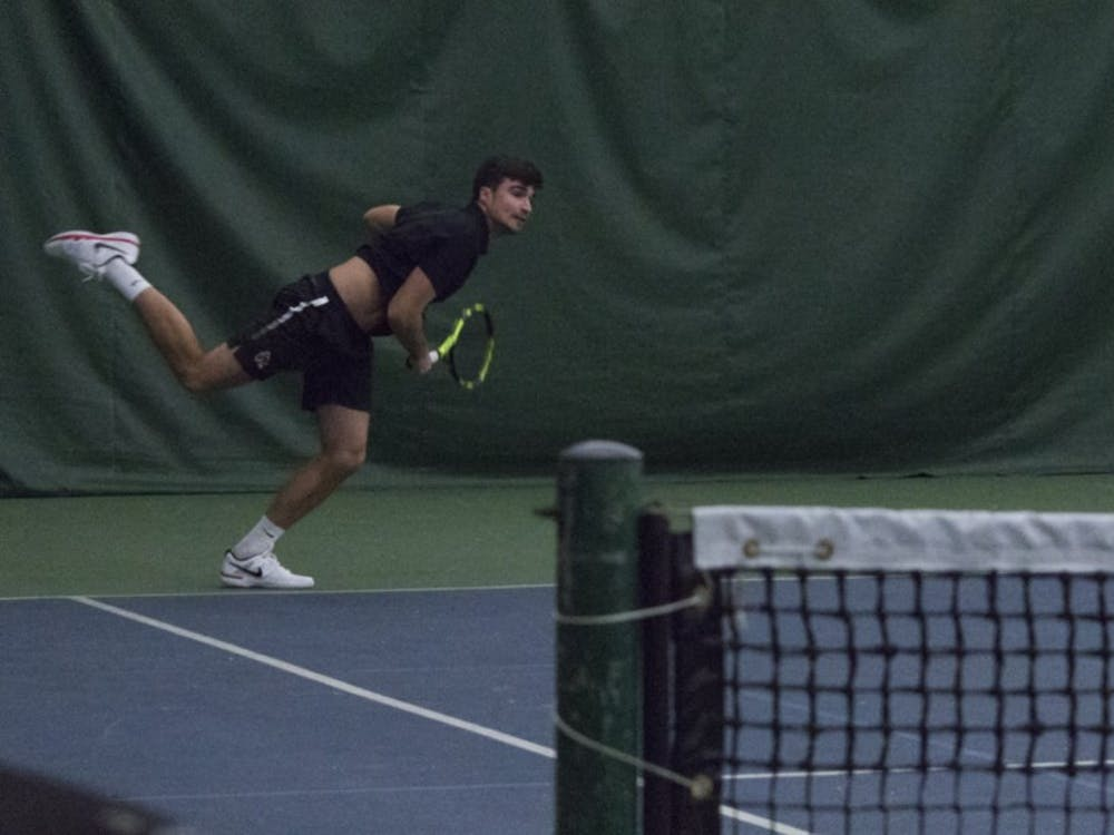 Ball State men's tennis player Namanja Guzina serves the ball during a doubles set against Eastern Illinois University on Jan. 20 at the Northwest YMCA of Muncie. Guzina and his partner, Thibault de Negri, won their set 6-4. Briana Hale, DN