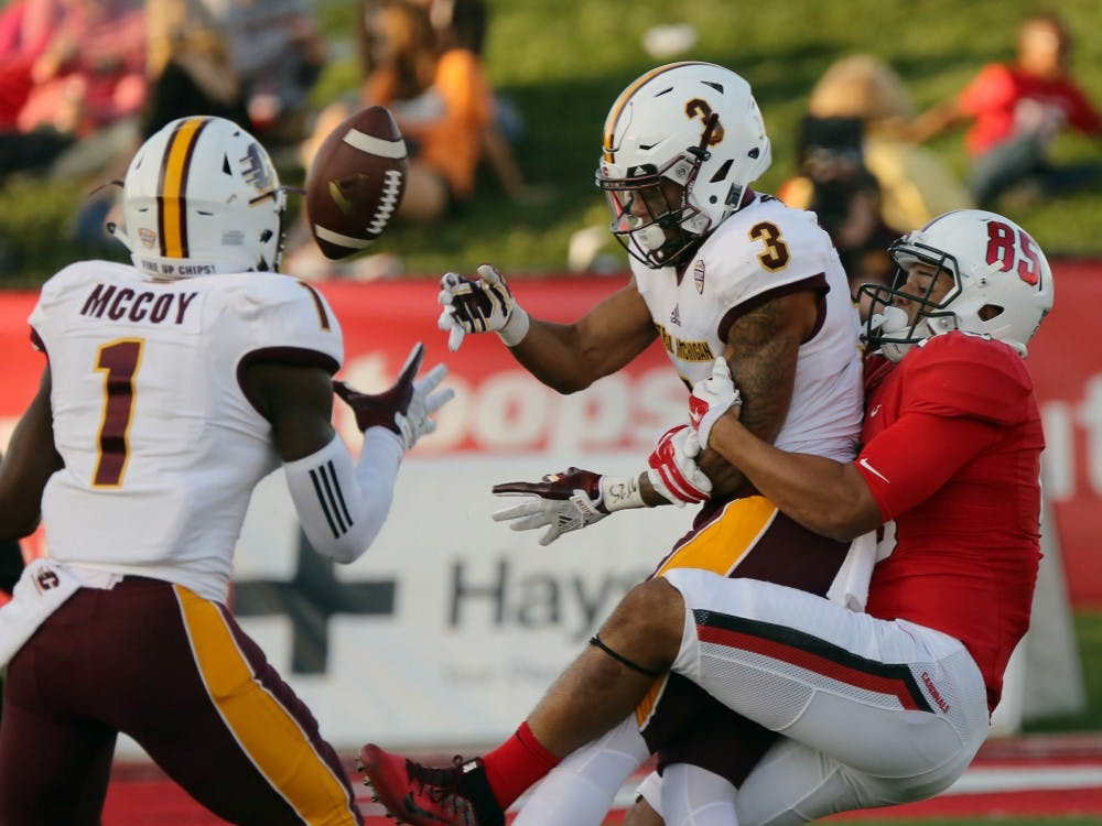 Redshirt sophomore wide receiver Antwan Davis causes Central Michigan's Sean Bunting to fumble the ball duringthe Cardinals' game against the Chippewas on Oct. 21 at Scheumann Stadium. Ball State is playing Toledo Oct. 26 at home. Paige Grider, DN