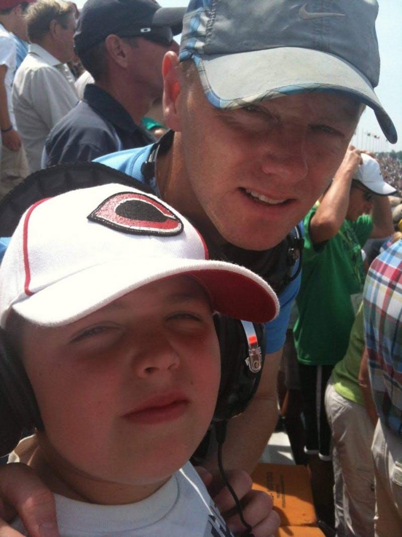 Larry Markle and his son Quentin smile for a picture at the Indianapolis 500 May 29, 2011, at Indianapolis Motor Speedway. It was Quentin's first time at the Indy 500, and he has now been to five. Larry Markle, Photo Provided