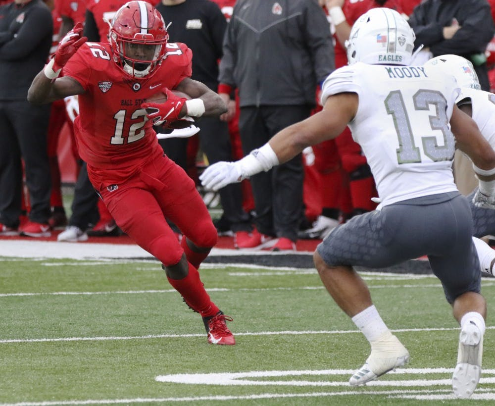 <p>Ball State sophomore wide receiver Justin Hall runs the ball during the Cardinals' game against Eastern Michigan Oct. 20, 2018, at Scheumann Stadium. Hall had 29 rushing yards. Paige Grider, DN</p>