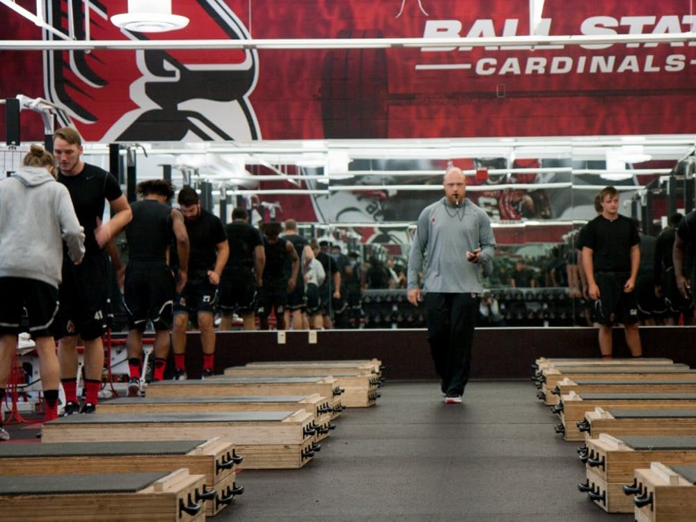 Ben Armer blows his whistle to start warm ups on Sept. 29 in the football weightroom. Armer is the director of strength and conditioning for Ball State's football team. Kaiti Sullivan, DN