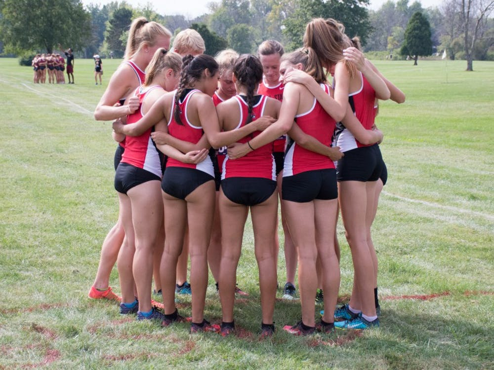 The Ball State team gathers before the meet begins at the cross country meet against IUPUI on Sept. 23, 2016 at the Muncie Elks Country Club.  Ball State won against IUPUI 16-46. Kaiti Sullivan // DN