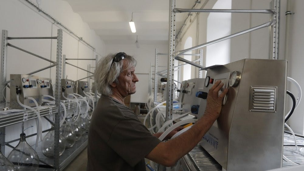 """A worker checks a lung ventilator """"Corovent"""" June 17, 2020, manufactured in Trebic, Czech Republic. A group of volunteers in the Czech Republic was working round the clock to prevent critical shortage of ventilators for COVID-19 patients. (AP Photo/Petr David Josek)"""