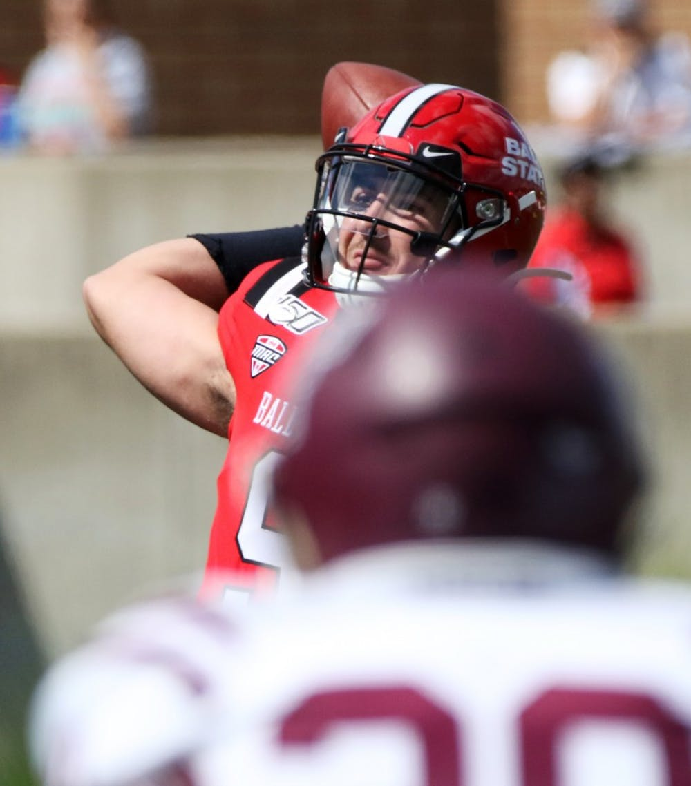 Ball State redshirt junior quarterback Drew Plitt throws a pass during the Cardinals' game against Fordham on Saturday, Sept. 7, 2019 at Scheumann Stadium. Plitt had 439 passing yards. Paige Grider, DN