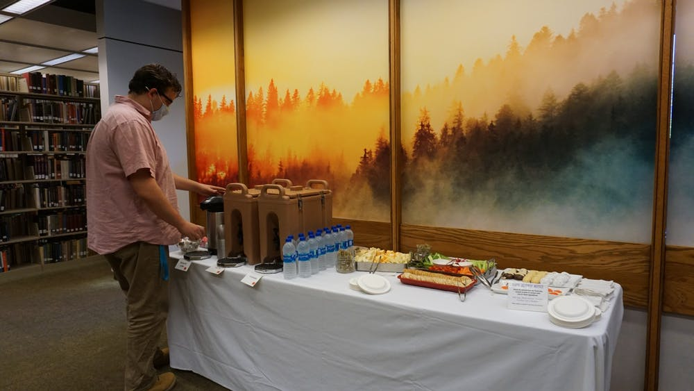 <p>A visitor fills a cup with coffee at Bracken Library&#x27;snewly-opened contemplation space Sept. 29, 2021. The opening of the area was celebrated with snacks and speeches from universityfaculty. <strong>Hannah Amos, DN</strong></p>