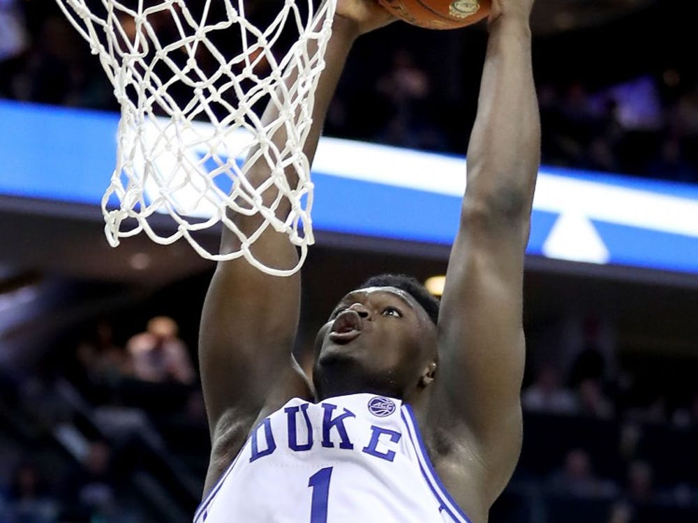 Duke's Zion Williamson dunks against he Florida State Seminoles during the championship game of the ACC Tournament at Spectrum Center in Charlotte, N.C., on Saturday, March 16, 2019. Duke won, 73-63. **FOR USE WITH THIS STORY ONLY** (Streeter Lecka/Getty Images/TNS)