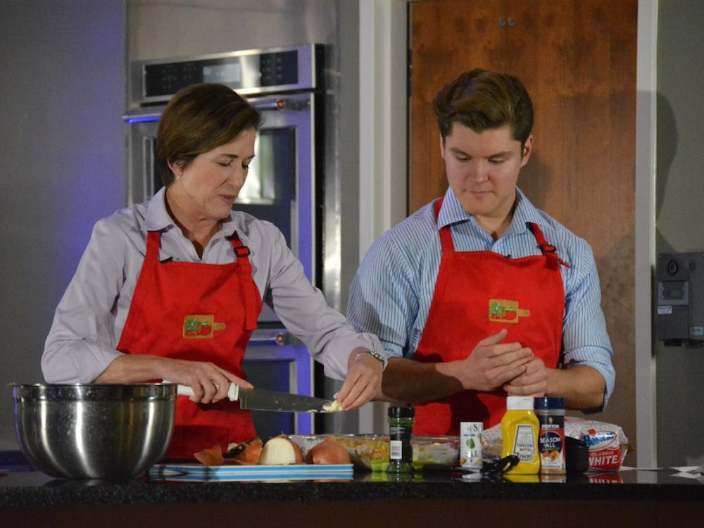 """Mrs. Mearns took part in the student cooking show """"Slice that Price"""" on Nov. 14 hosted by Cameron Bowen. Mearns demonstrated how to make her mother's Thanksgiving stuffing. Korina Valenzuela, Photo Provided"""