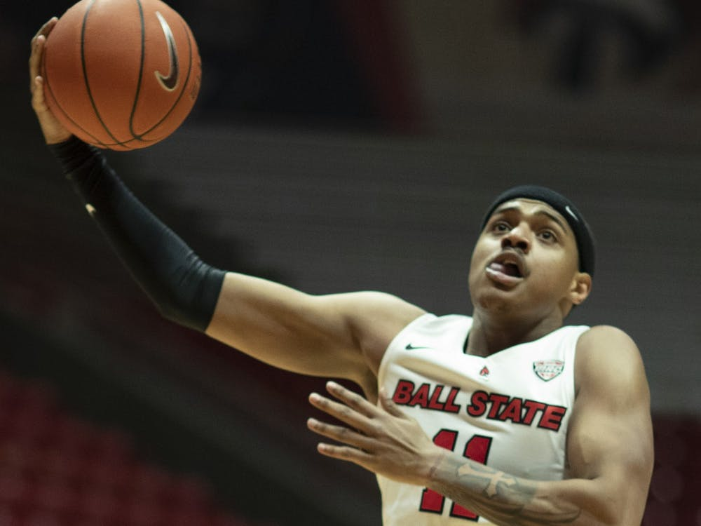 Ball State Cardinals redshirt sophomore guard Jarron Coleman goes for a dunk during a game against the Kent State Golden Flashes Feb. 24, 2021, at John E. Worthen Arena. The Cardinals beat the Golden Flashes 90-71. Jacob Musselman, DN