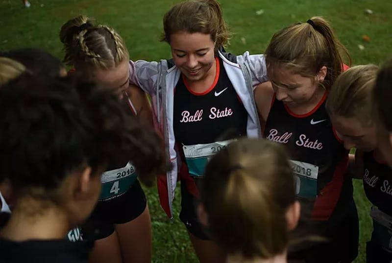 The Ball State Run Club women's team meets up before a cross country race. Hollyn Anderson, vice president of the Run Club, said she enjoys the environment of the races, and likes that it isn't as much of a commitment level as the official Ball State cross country and track team. Zack DeSimone, Photo Provided