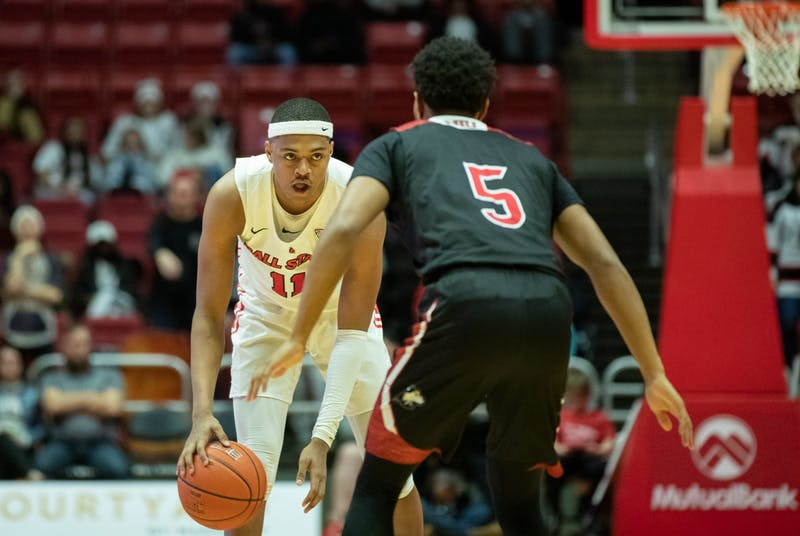 Redshirt freshman guard Jarron Coleman gets ready to cross up sophomore guard Zaire Mateen Feb. 11, 2020, at John E. Worthen Arena. Coleman had five points against the Huskies. Jacob Musselman, DN