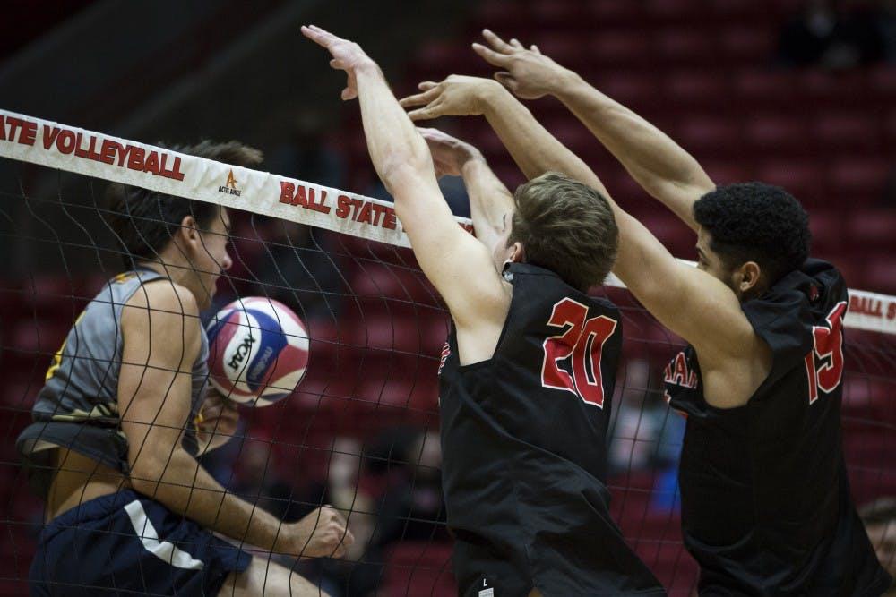 <p>Junior outside hitter David Siebum and red shirted sophomore middle attacker Lem Turner pushes a kill back over the net against a Emmanuel Lions attacker, Jan. 6, at John E. Worthen Arena. Ball State swept the Lions, in three straight sets, 16-25, 15-25, 12-25. <strong>Grace Hollars, DN</strong>&nbsp;</p>