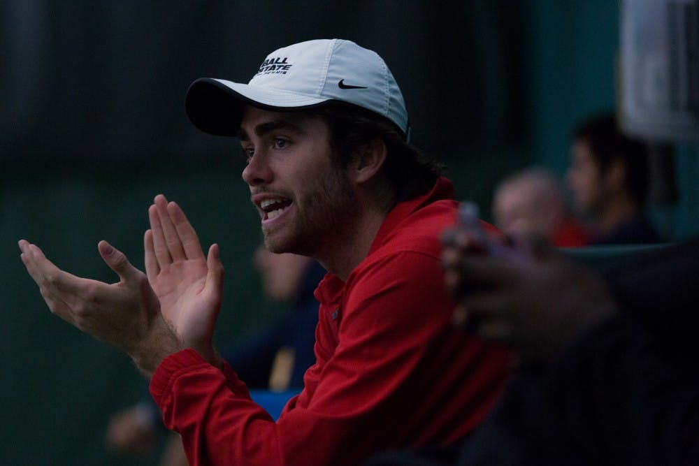 <p>Junior Tom Carney cheers on teamate Conner Andersen during Ball State's game against the University of Toledo. Ball State won 5 to 2 on March 24 at Northwest YMCA in Muncie. <strong>Eric Pritchett, DN</strong></p>