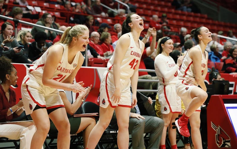 (left to right) Sophomore forward Blake Smith, freshman forward Annie Rauch and freshman guard Estel Puiggros celebrate on the sideline Feb. 19, 2020 at John E. Worthen Arena. Ball State won 97-89 against Northern Illinois. Katie Hawkins, DN