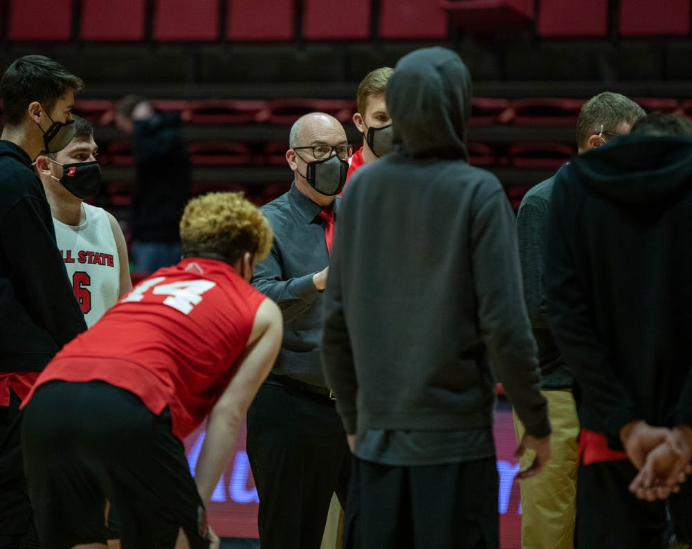 <p>Head coach Joel Walton talks to his team after the match Jan. 29, 2021, in John E. Worthen Arena. Ball State won against Lincoln Memorial University 3-1. <strong>Jaden Whiteman, DN</strong></p>
