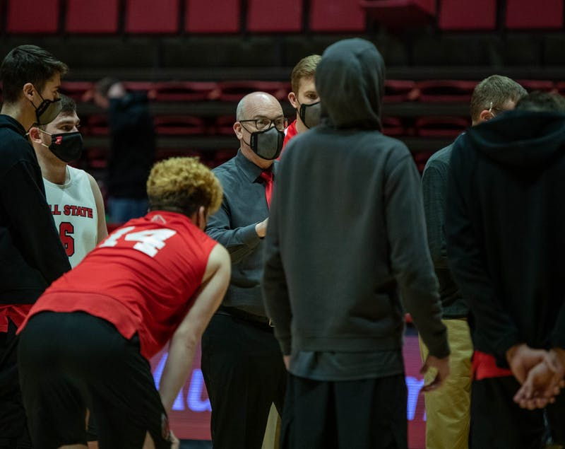 Head coach Joel Walton talks to his team after the match Jan. 29, 2021, in John E. Worthen Arena. Ball State won against Lincoln Memorial University 3-1. Jaden Whiteman, DN