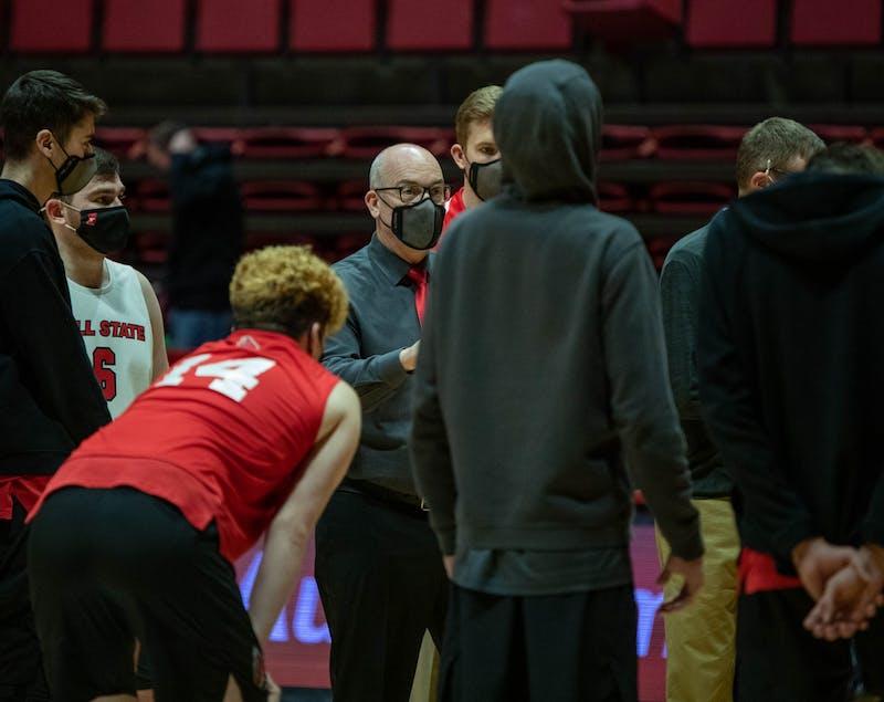 Head coach Joel Walton talks to his team after the match Jan. 29, 2021, in John E. Worthen Arena. Ball State won against Lincoln Memorial University 3-1. Jaden Whiteman, DN