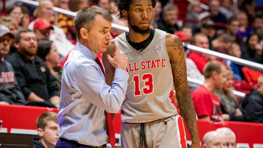 Head coach James Whitford talks with redshirt freshman guard/forward, Kani Acree (13), before entering the game late in the second half against Loyola Chicago Dec. 3, 2019, at John E. Worthen Arena. Acree played eight crucial minutes. Omari Smith, DN