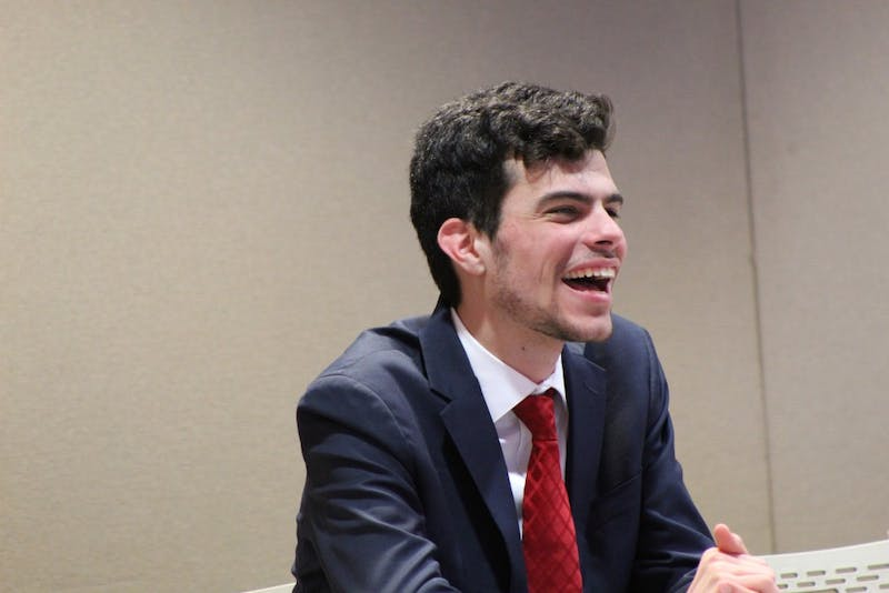 Elected President Pro Tempore Carter Gallagher laughs at another senator's joke. Gallagher was voted by the senate to be next semester's president pro tempore at the senate meeting Wednesday, March 27 at the L.A. Pittenger Student Center. Charles Melton, DN