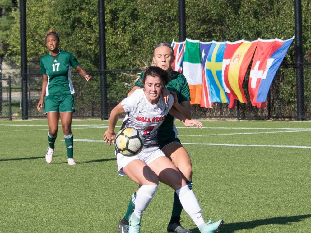 Junior Lauren Roll battles for the ball against an Eastern Michigan University player at Briner Sports Complex on Oct. 13. Rebecca Slezak, DN File