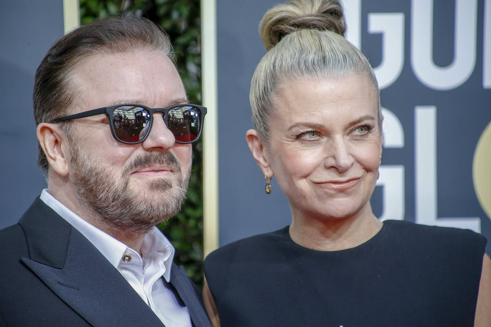 Ricky Gervais and Jane Fallon arrive at the 77th Golden Globe Awards at the Beverly Hilton in Beverly Hills, Calif., on Sunday, Jan. 5, 2020. (Marcus Yam/Los Angeles Times/TNS)