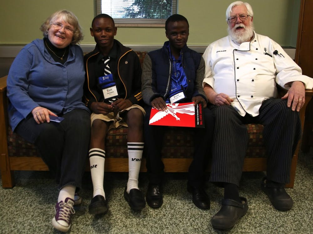 Adam Kahindi and Chemwemwe Jussa are taken home from the Student Center by the Robey family April 11. Students from Africa are taken in by host families for two weeks to experience American living as a part of the Pan-American Youth Leadership Program. Rebecca Slezak, DN