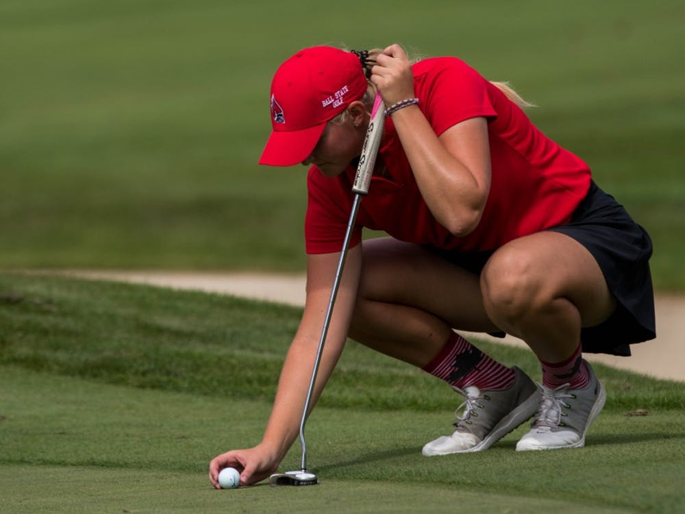 Freshman Dylann Armstrong lines up a putt Sept. 17, 2018, at the Players Club at Woodland Trails in Yorktown, Indiana, during the Cardinal Classic golf tournament. The Cardinal Classic is a two-day event with 36 holes played the first day and 18 played the second day. Eric Pritchett,DN