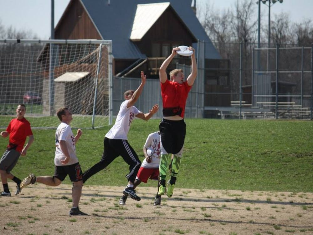 Ball State students play a round of Ultimate Frisbee. Tim Perkey, president of Ball State