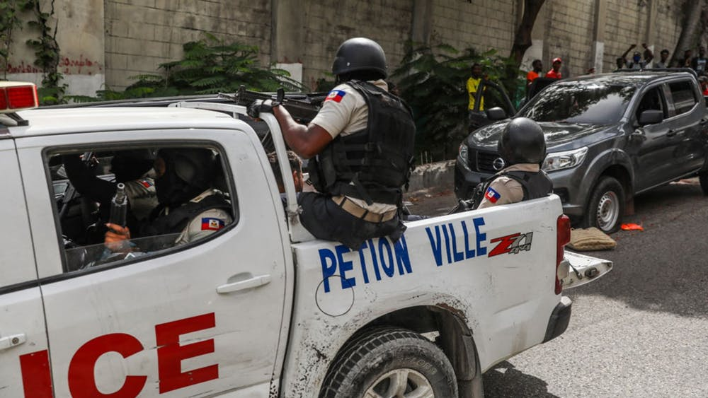Two men accused of being involved in the assassination of Haiti President Jovenel Moise are transported to the Petion-Ville station in a police car in Port-au-Prince on July 8, 2021. (Valerie Baeriswyl/AFP via Getty Images/TNS)