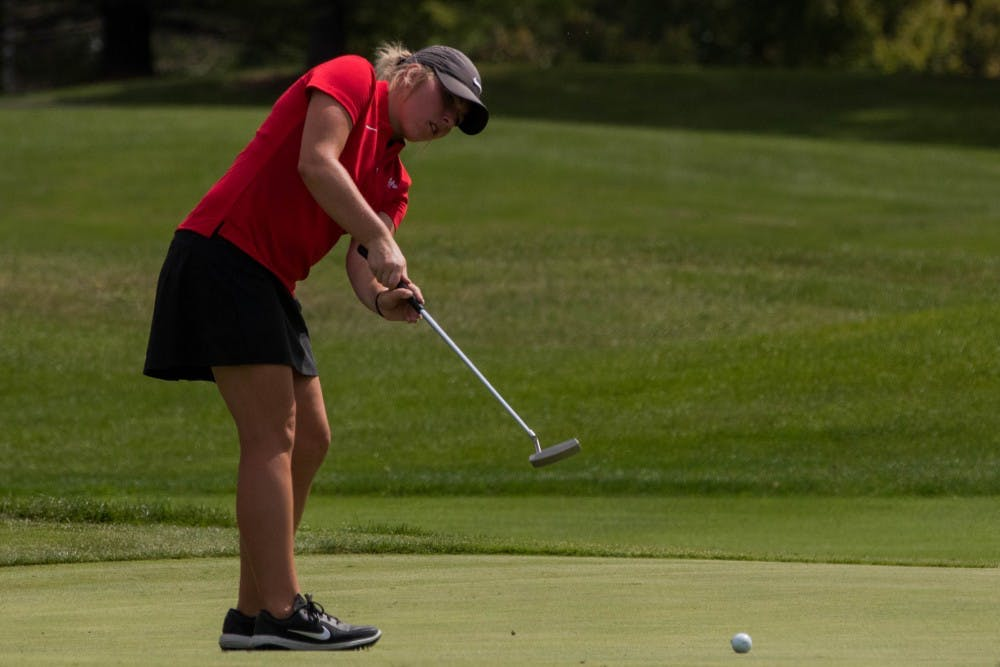 Sophmore Emily Knouff putts at the Players Club at Woodland Trails in Yorktown, Indiana Sept. 17, 2018 during the Cardinal Classic Golf Tournament. The Cardinals were one of 17 teams represented for the tournament. Eric Pritchett,DN