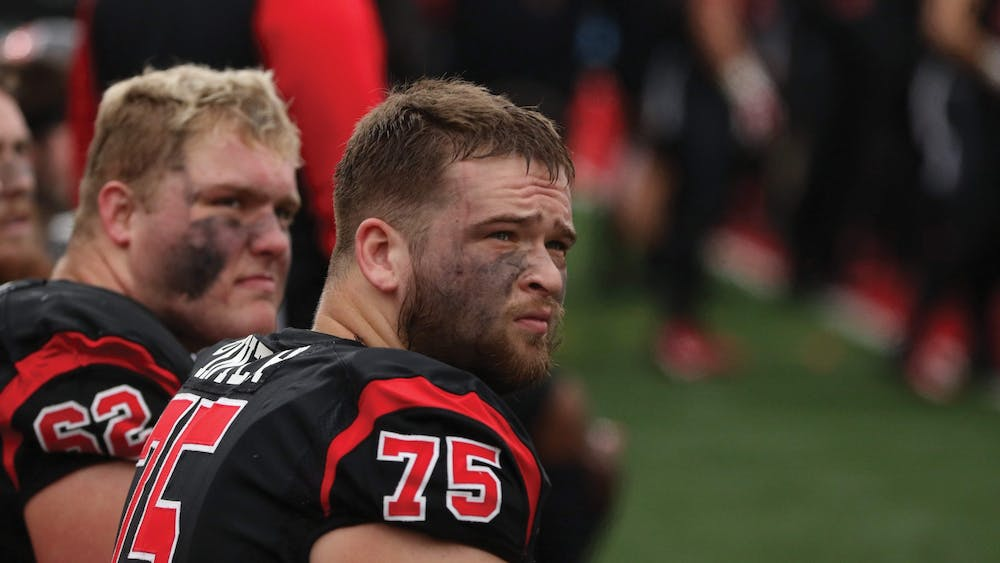 Danny Pinter, former Ball State offensive lineman and NFL draft prospect, sits on the sideline of the Senior Day game against Miami (Ohio) Nov. 28, 2019, at Scheumann Stadium. Pinter partnered with the Boys and Girls Clubs of Muncie to donate money for each rep he completed during the bench press test at the NFL combine. Pinter put up 24 reps and raised a total of $2,160. Jacob Musselman, DN