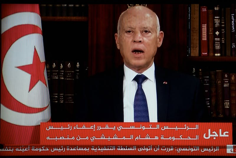 In a photo taken from a television, Tunisian President Kais Saied announces the dissolution of parliament and Prime Minister Hichem Mechichi's government on Sunday, July 25, 2021 at Carthage Palace after a day of nationwide protest. (Fethi Belaid/AFP/Getty Images/TNS)