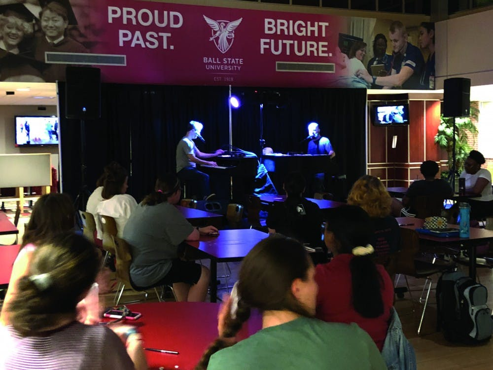 """Adam Nelson and Rusty Northrop from Midwest Dueling Pianos perform requested songs Sept. 12, 2019 in the Student Center Tally. Some of the requested songs Nelson and Northrop played include Vanessa Carlton's """"A Thousand Miles"""" and Smash Mouth's """"All Star."""" Grace McCormick, DN."""