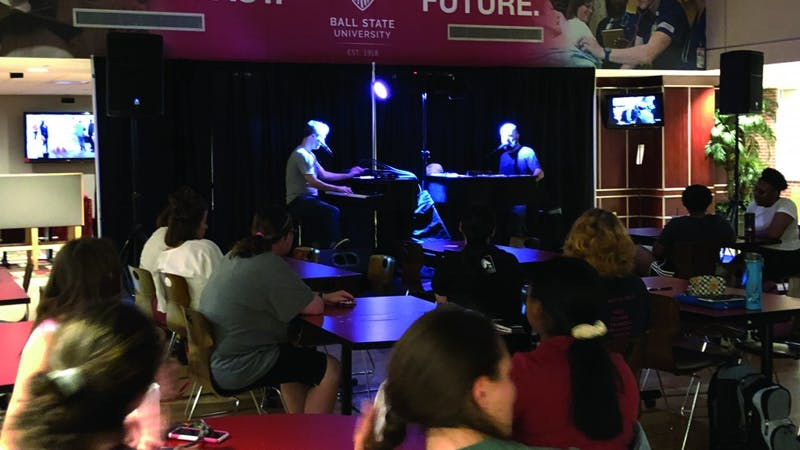 "Adam Nelson and Rusty Northrop from Midwest Dueling Pianos perform requested songs Sept. 12, 2019 in the Student Center Tally. Some of the requested songs Nelson and Northrop played include Vanessa Carlton's ""A Thousand Miles"" and Smash Mouth's ""All Star."" Grace McCormick, DN."