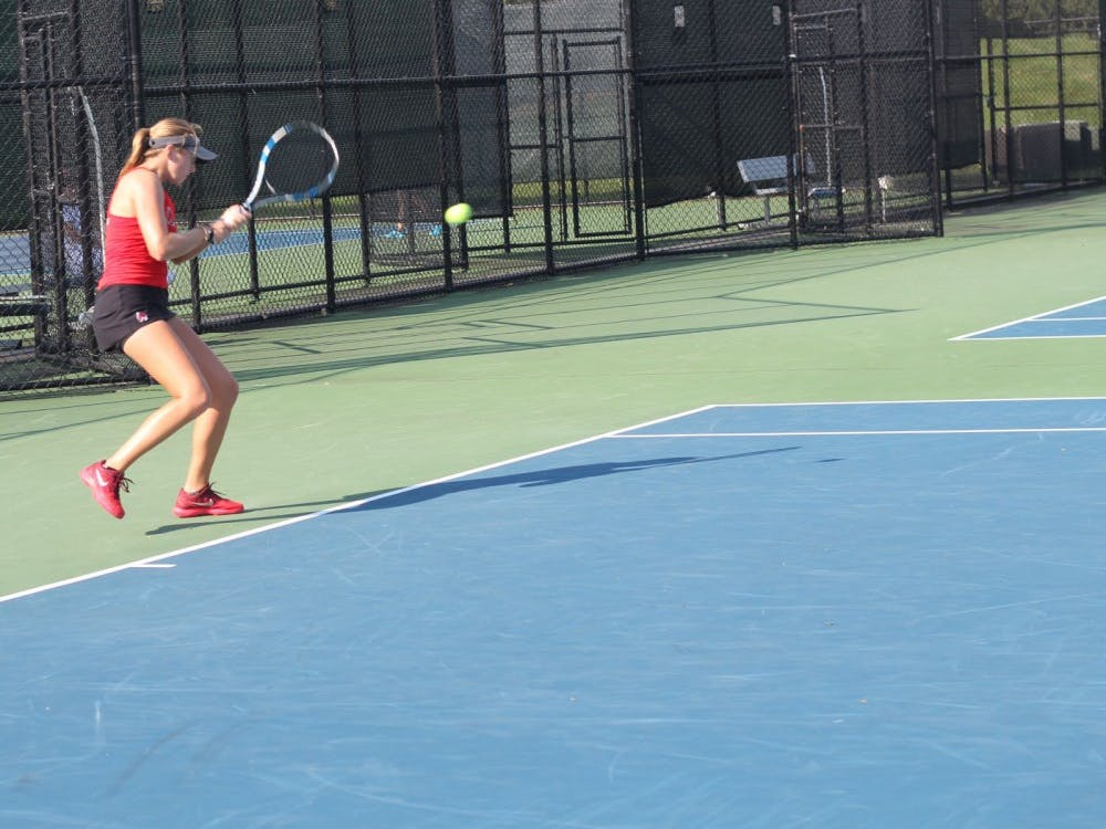 Senior Sarah Swiderski returns the ball to a Detroit Mercy player in a singles match during the Hidden Dual Tournament Sept. 22, 2018, at the Cardinal Creek Tennis Center. Swiderski went 1-1 in her singles matches. Patrick Murphy, DN