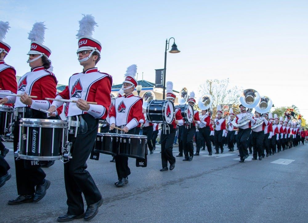 <p>Members of the Pride of Mid-America (POMA) Marching Band perform at the Homecoming Parade on Saturday, Oct. 19, 2019 in the Village. The parade will return for fall 2021 Homecoming. <strong>Jaden Whiteman, DN File</strong></p>