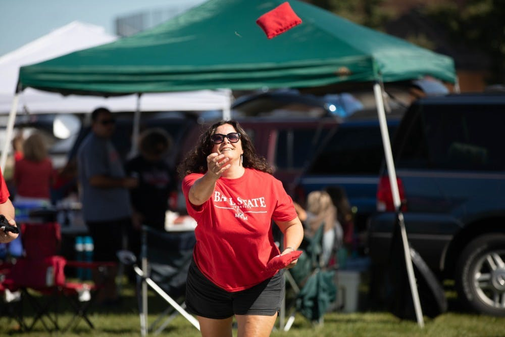 <p>A Ball State mom plays cornhole at the tailgate on Sept. 14, 2019, outside Scheumann Stadium. Charlie Town, located near the Alumni Center, is one tailgating opportunity for families and visitors. <strong>Jacob Musselman, DN File</strong></p>