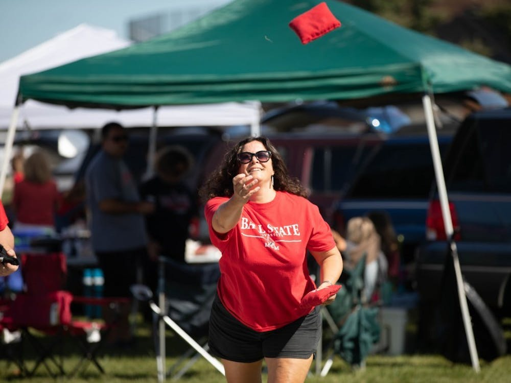 A Ball State mom plays cornhole at the tailgate on Sept. 14, 2019, outside Scheumann Stadium. Charlie Town, located near the Alumni Center, is one tailgating opportunity for families and visitors. Jacob Musselman, DN File