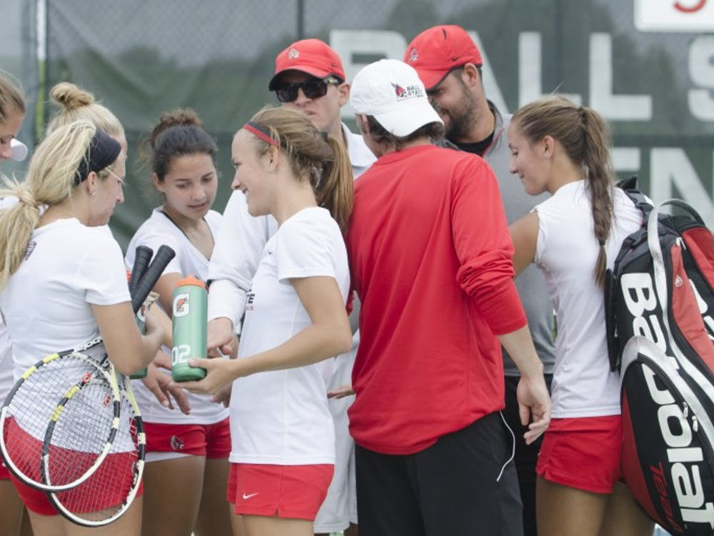 The Ball State women's tennis team huddles up at the end of the doubles match against Butler for the Fall Dual on Sept. 20 at the Cardinal Creek Tennis Center. DN PHOTO BREANNA DAUGHERTY