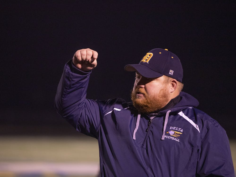 Eagles' head coach Chris Overholt delivers his postgame remarks following Delta's victory over Wayne at Delta High School Oct. 30, 2020. The Eagles defeated the Generals 49-18. Connor Smith, DN.