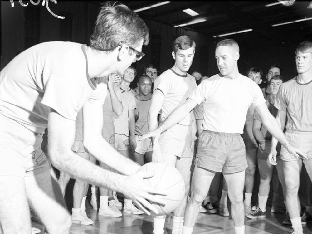 John Reno teaches a Ball State physical education class in 1966 at Irving Gymnasium. Reno was inducted into the Ball State Athletics Hall of Fame in 1991. Ball State Digital Media Repository, Photo Courtesy