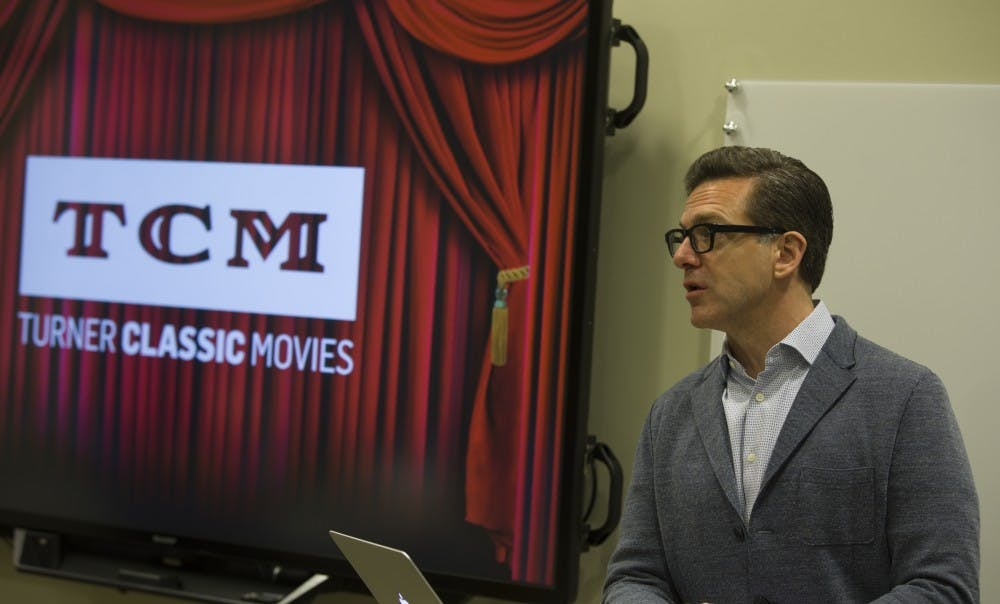 """<p>Turner Classic Movies (TCM) executive Shannon Clute addresses students in the """"Let's Movie Design Studio"""" course. Led by Richard Edwards, executive director for strategic learning, students in the class make products for TCM. <strong>Robbie Mehling, Photo Provided</strong></p>"""