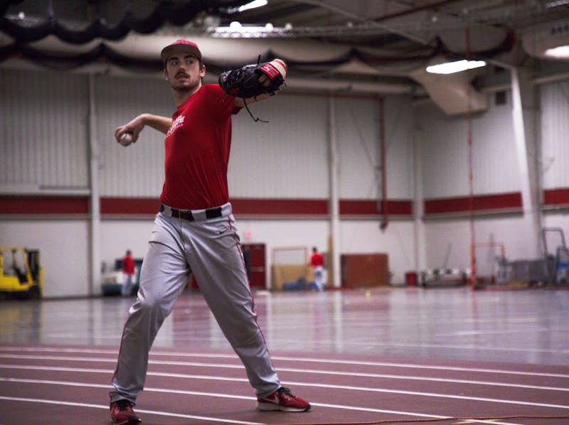 Junior pitcher John Baker throws a ball during a drill at practice Jan. 29, 2019, at the Field Sports Building. Baker led the Cardinals with 15 starts in the 2018 season along with a 3.68 ERA. Zach Piatt, DN