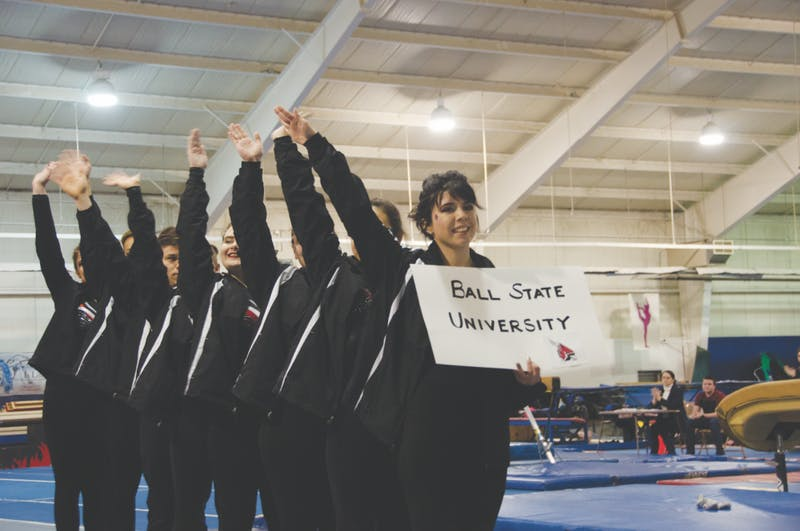 The Ball State Club Gymnastics team salutes the crowd at the inaugural Cardinal Cup on Feb. 2 at Anderson Gymnastics and Cheer. The team practices three times a week in Muncie and Anderson. Jack Williams, DN